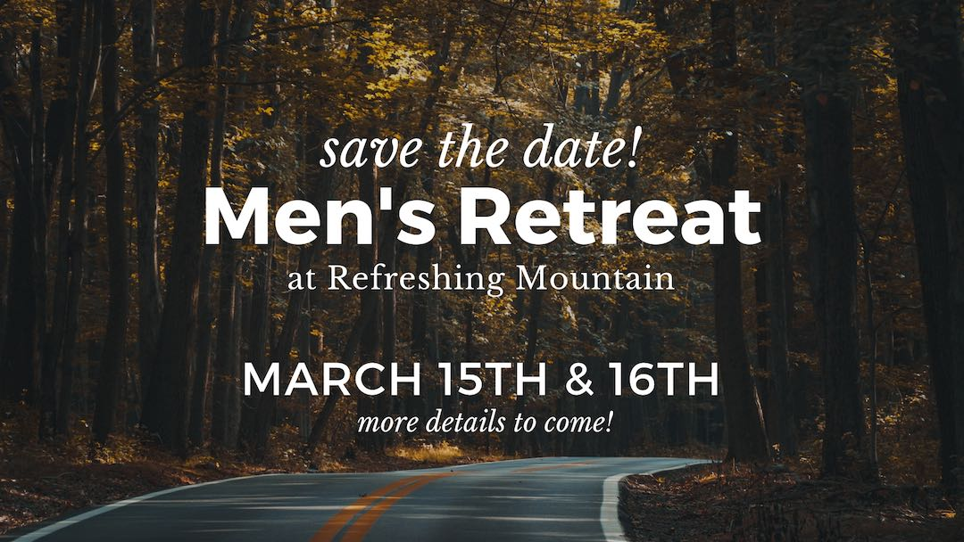 "Road going through the woods, with text over top saying, ""Men's Retreat"""